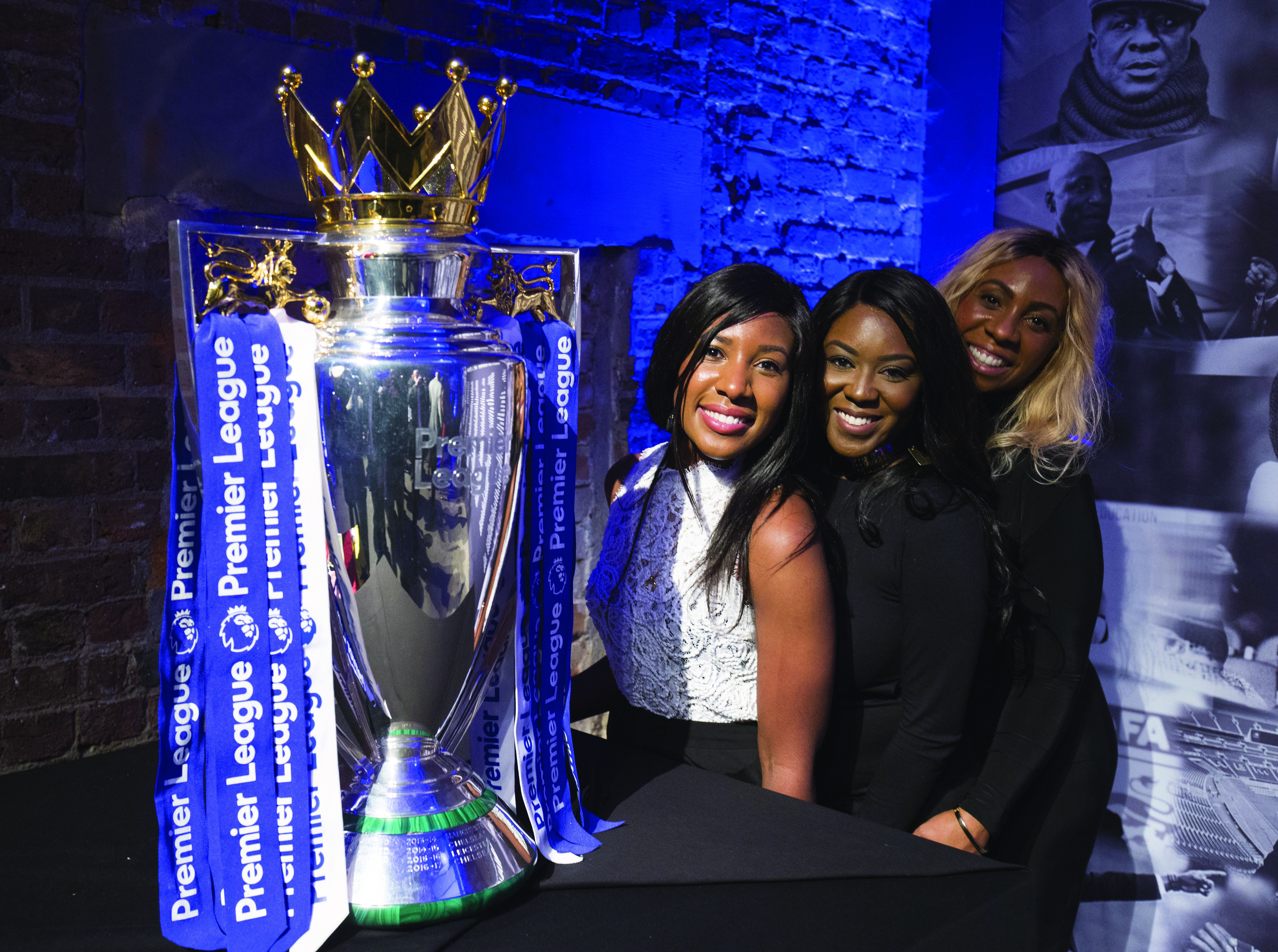 LONDON, ENGLAND - NOVEMBER 08: Guests posing with the Premier League trophy at The Black Football List Celebration on November 8, 2017 in London, England. (Photo by Henry Browne/Getty Images for Premier League)